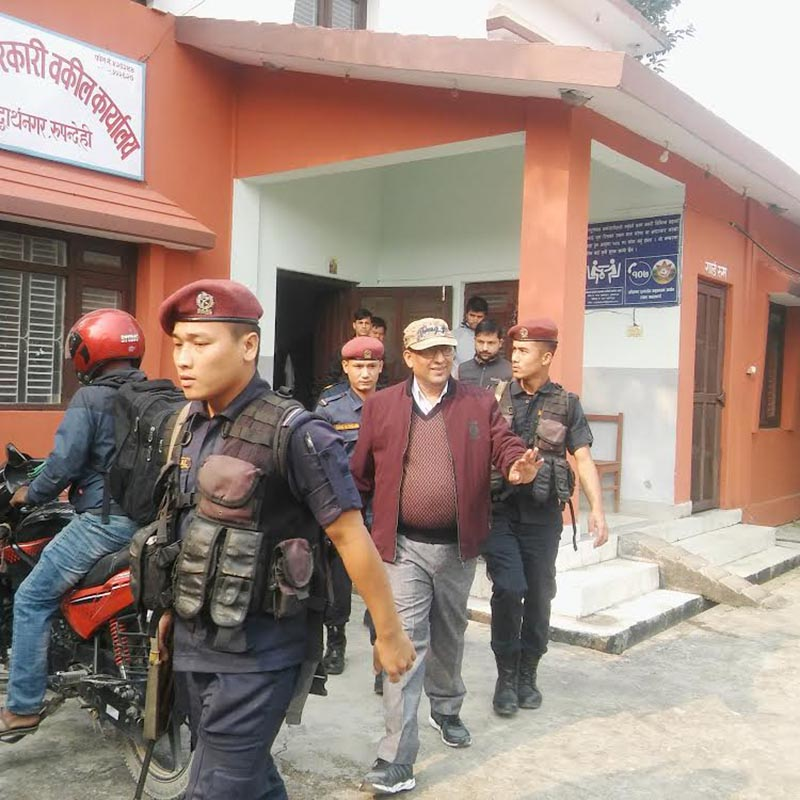 A team from the Commission for the Investigation of Abuse of Authority taking district attorney Kosh Hari Niraula to Kathmandu for further probe, in Rupandehi, on Tuesday, November 20, 2018. Photo: THT