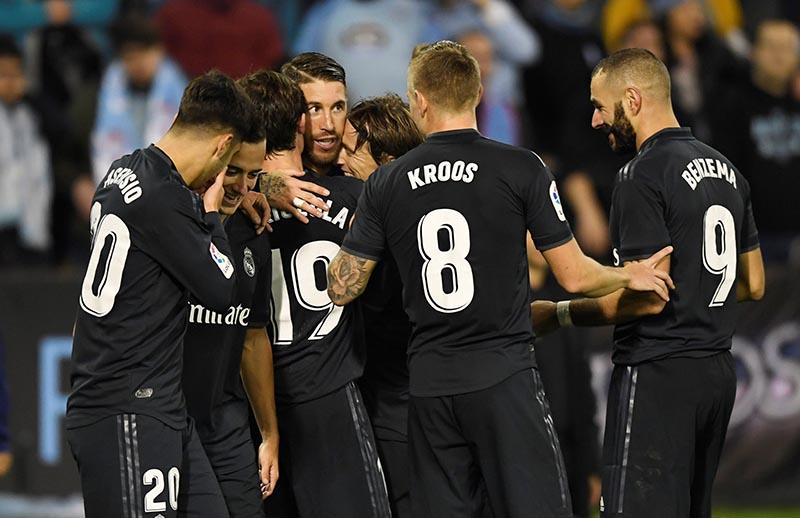Real Madrid's Sergio Ramos celebrates scoring their third goal with Karim Benzema and team mates during the La Liga Santander match between Celta Vigo and Real Madrid, at Balaidos, in Vigo, Spain, on November 11, 2018. Photo: Reuters