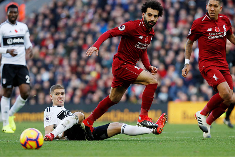 Liverpool's Mohamed Salah in action with Fulham's Maxime Le Marchand. Photo: Reuters