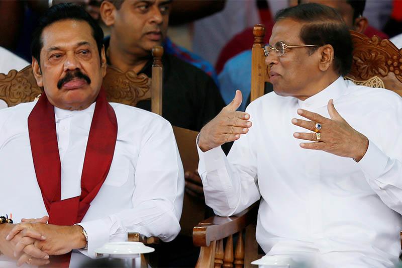 FILE PHOTO: Sri Lanka's newly appointed Prime Minister Mahinda Rajapaksa and President Maithripala Sirisena talk during a rally near the parliament in Colombo, Sri Lanka November 5, 2018. Photo: Reuters