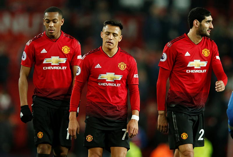 Manchester United's Anthony Martial, Alexis Sanchez and Marouane Fellaini look dejected after the Premier League between Manchester United and Crystal Palace, at Old Trafford, in Manchester, Britain, on November 24, 2018. Photo: Reuters