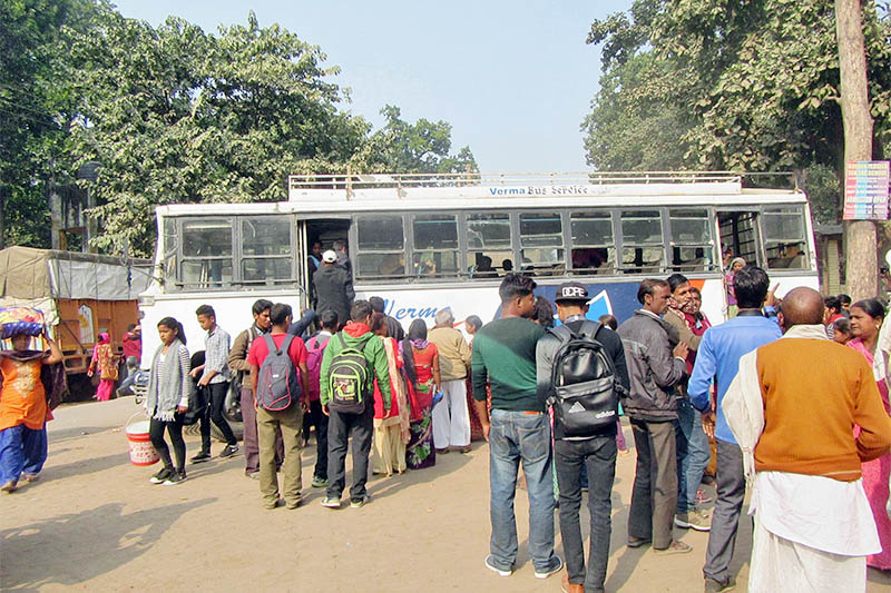 Nepali migrant workers preparing to board a bus to India, after celebrating Dashain and Tihar with their loved ones, in Kailali district, on Monday, November 12, 2018. Photo: RSS
