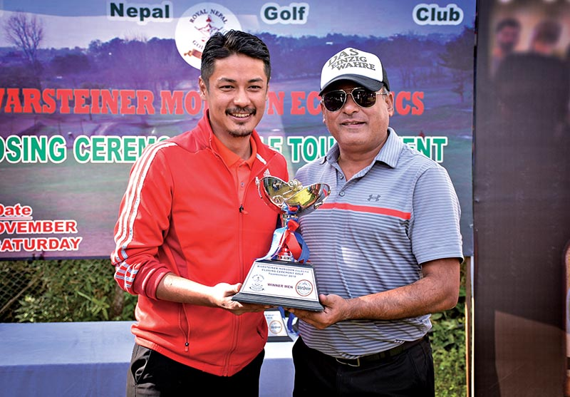 Director of JGI Group Shrihar SJB Rana handing over the Warsteiner Monsoon Eclectic Closing Ceremony Golf Tournament trophy to Swadesh Gurung (left) at the Royal Nepal Golf Club in Kathmandu on Saturday. Photo: THT