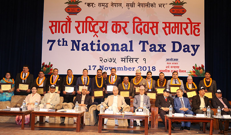 A group photo taken during the seventh National Tax Day ogranised by Inland Revenue Department under the Ministry of Finance, in Kathmandu, on Saturday, November 17, 2018. Photo: RSS
