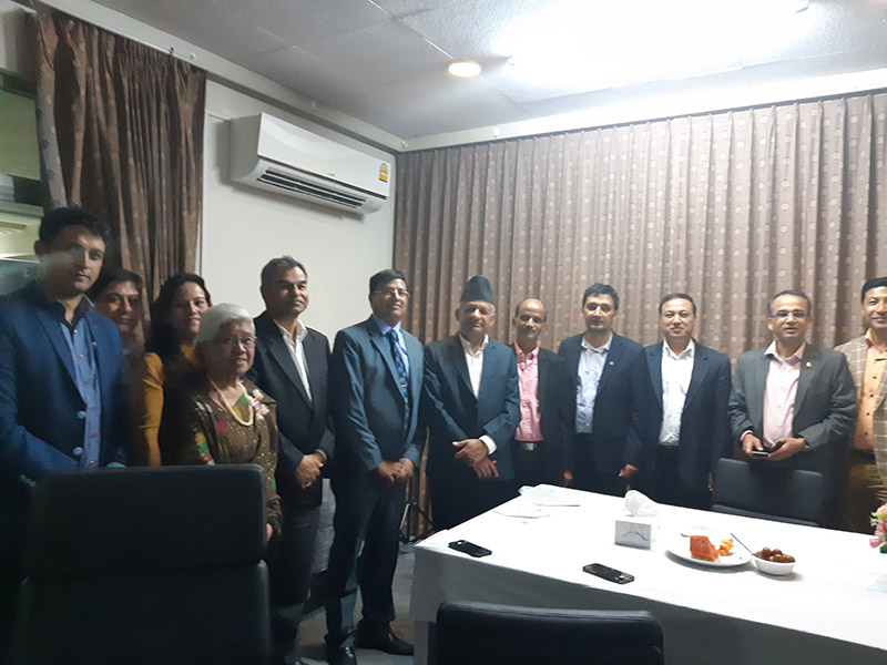A group photo taken during an interaction programme where Nepal Policy Institute (NPI) team handed over NRNAu2019s official request letter to Minister for Foreign Affairs Pradeep Kumar Gyawali, at the Embassy of Nepal, in Bangkok on Thursday, November 22, 2018. Photo: NPI Secretariat