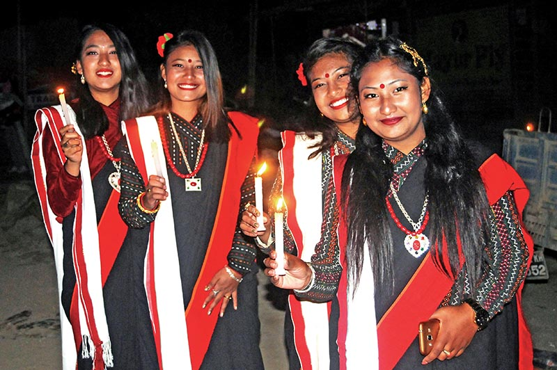 Women in traditional attire holding candles to mark Nepal Sambat at Lele village, in Lalitpur. Photo: THT