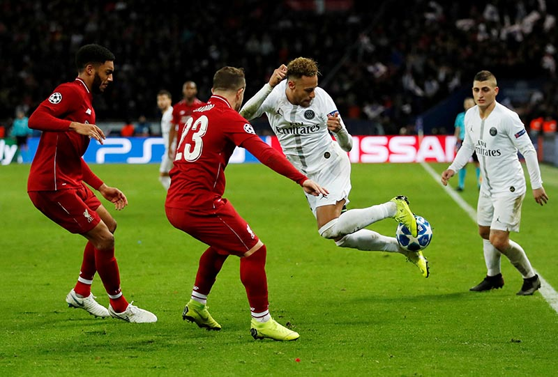 Paris St Germain's Neymar in action with Liverpool's Xherdan Shaqiri and Joe Gomez during the Champions League, Group Stage match of Group C between Paris St Germain and Liverpool, at Parc des Princes, in Paris, France, on November 28, 2018. Photo: Action Images via Reuters