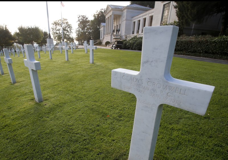 FILE - This file photo taken on Friday, Nov. 2, 2018 shows the graves of US nurses Dorothy Cromwell, left, and Gladys Cromwell, right, at the American Cemetery in Suresnes, near Paris, France. Photo: AP