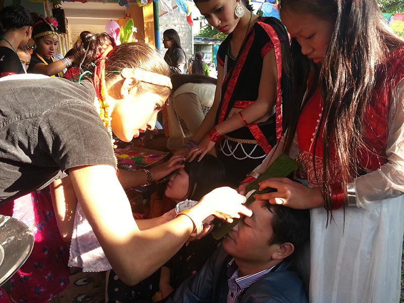 Students at Rainbow Children Home offer 'Tika' to Foreign tourists participating in a Bhaitika programme organised by Western Hotel Association at Butterfly Child Care Centre in Pokhara Lakeside, on Friday, November 9, 2018. Photo: Rup Narayan Dhakal/THT