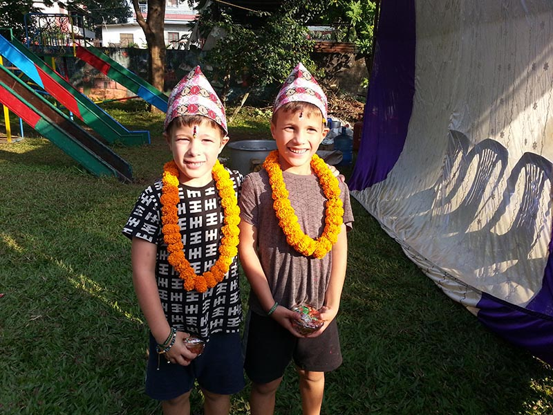 Foreign children pose for a photograph while participating in a Bhaitika programme organised by Western Hotel Association at Butterfly Child Care Centre in Pokhara Lakeside, on Friday, November 9, 2018. Photo: Rup Narayan Dhakal/THT