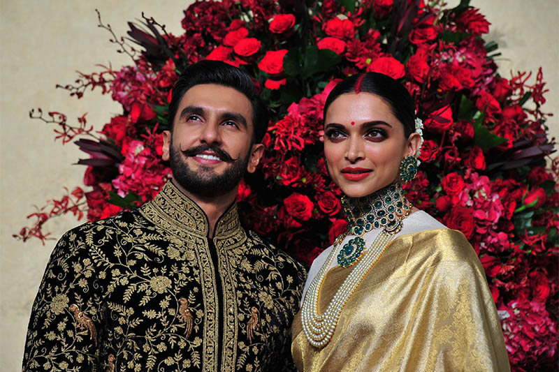 Bollywood actors Ranveer Singh and Deepika Padukone pose during a photo-op at their wedding reception in Bengaluru, India, November 21, 2018. Photo: Reuters