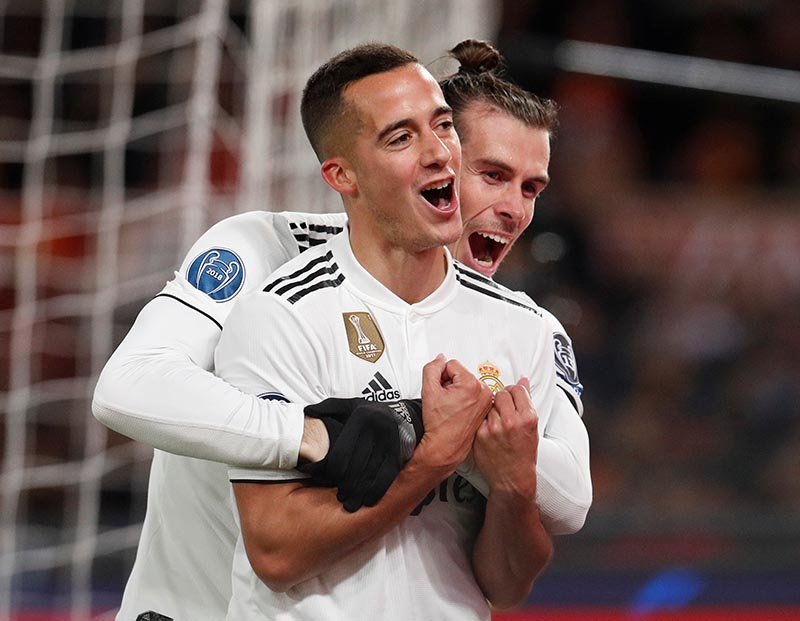 Real Madrid's Lucas Vazquez celebrates with Gareth Bale after scoring their second goal during the Champions League Group Stage Group G match between AS Roma and Real Madrid, at Stadio Olimpico, in Rome, Italy, on November 27, 2018. Photo: Reuters