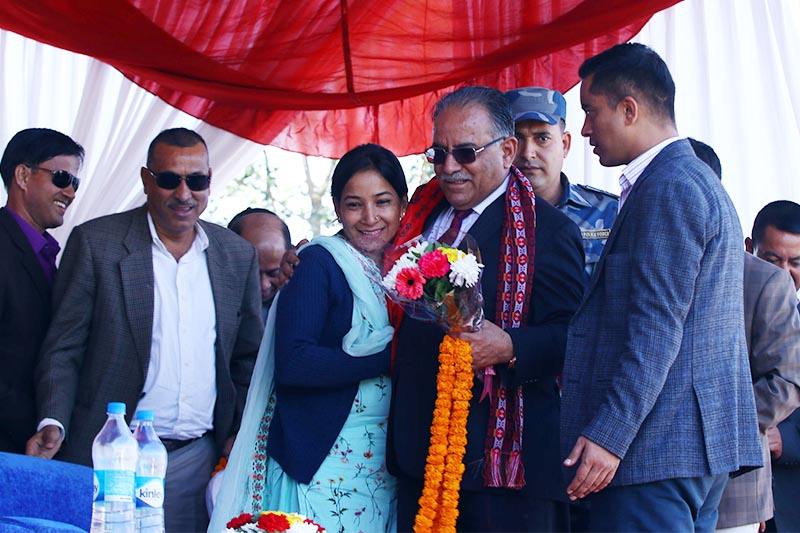 Bharatpur Metropolis Mayor Renu Dahal (centre-left) welcomes Nepal Communist Party Co-chair Pushpa Kamal Dahal at a function organised to distribute medal ceremony after the conclusion of  Pokhara Premier League, in Pokhara, on Tuesday, November 6, 2018. Photo: RSS