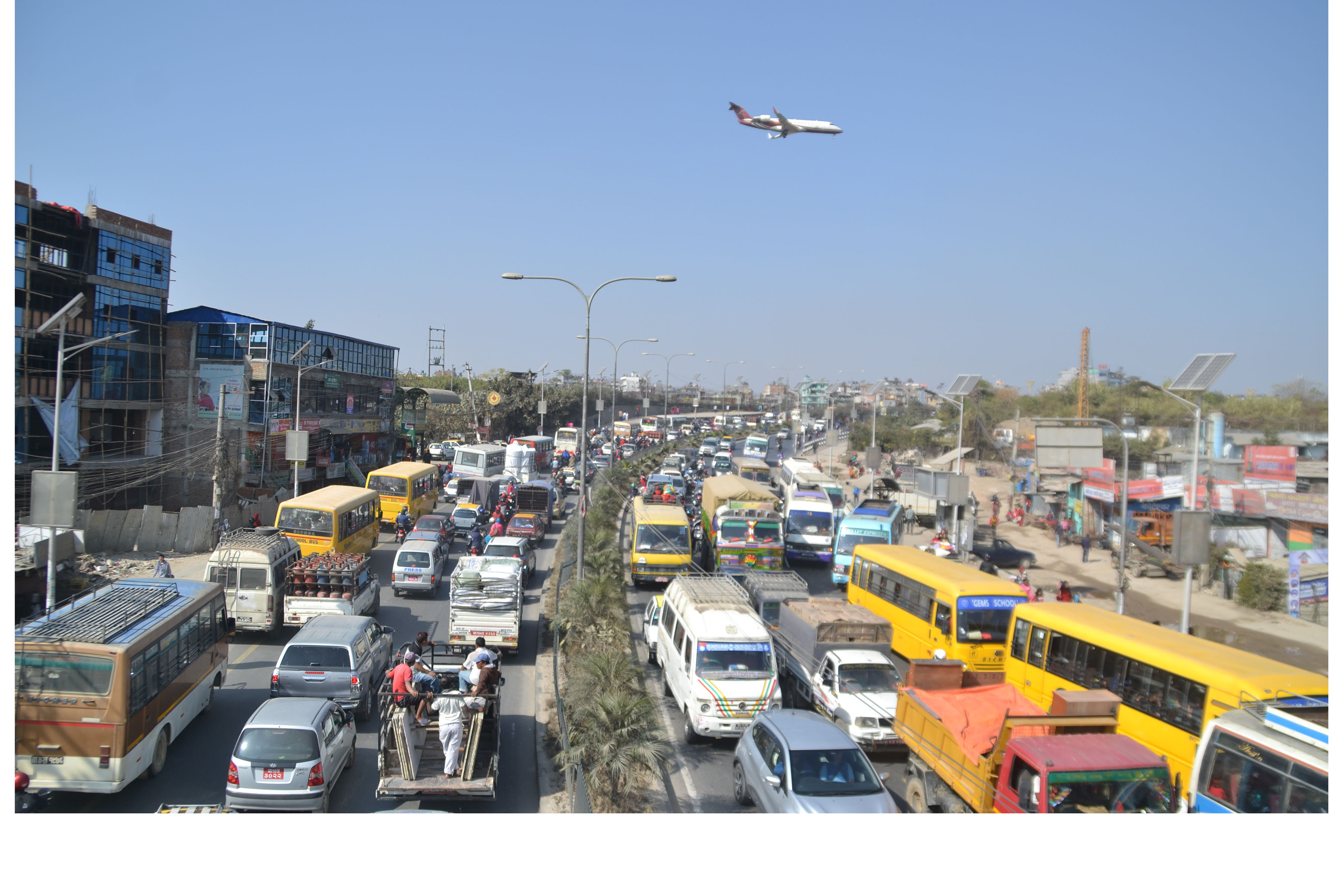 FILE - Vehicles await to ply past a traffic jam at Koteshwor-Jadibuti road section as an aircraft flies overhead, on Monday, November 12, 2018. Photo: RSS