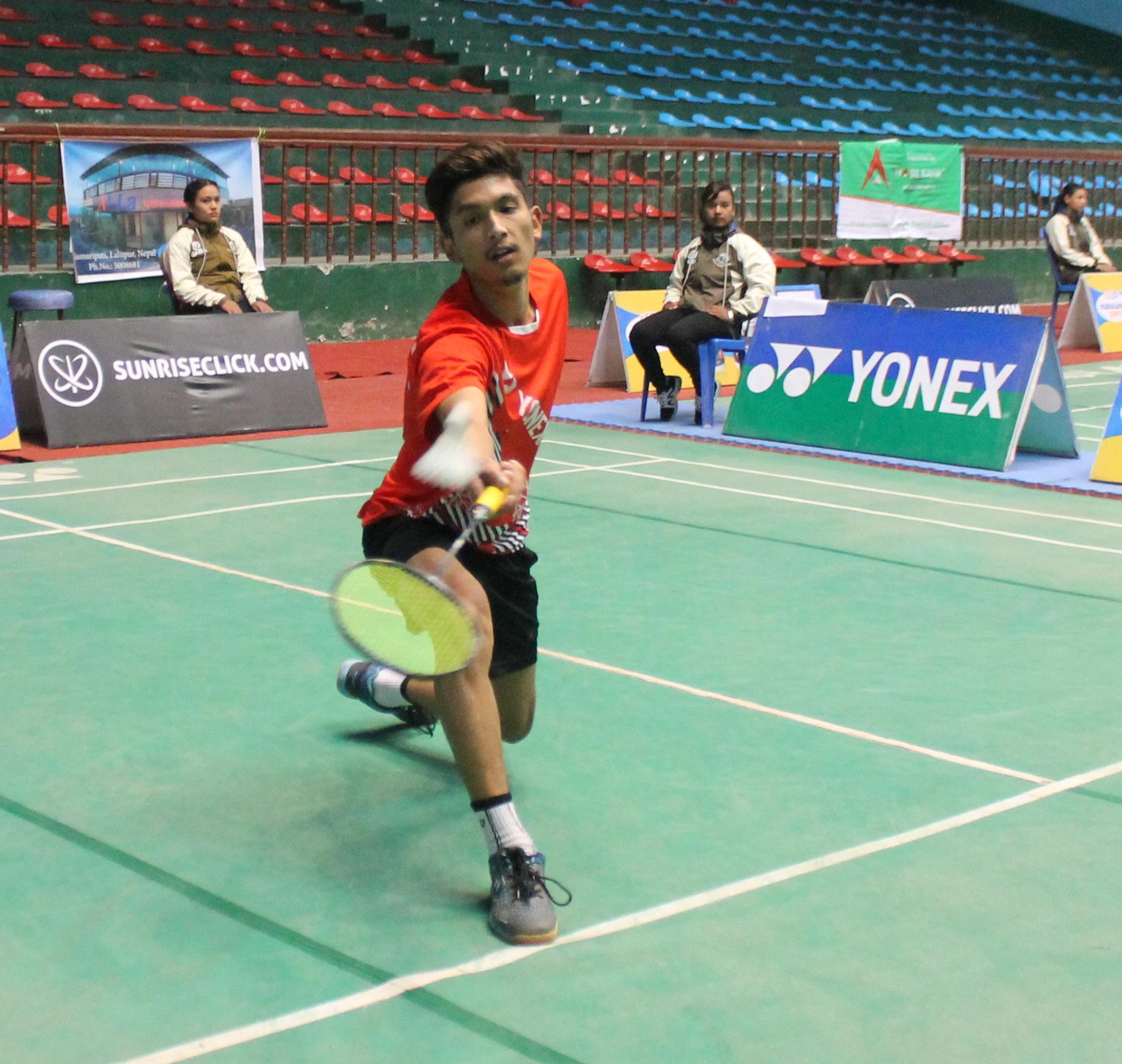 Rukesh Maharjan of TAC returns to Bishnu Katuwal of NPC during their menu2019s singles quarter-final match of the Yonex Sunrise eighth Pushpalal Memorial National Open Badminton Tournament in Kathmandu on Thursday, November 15, 2018. Photo: THT