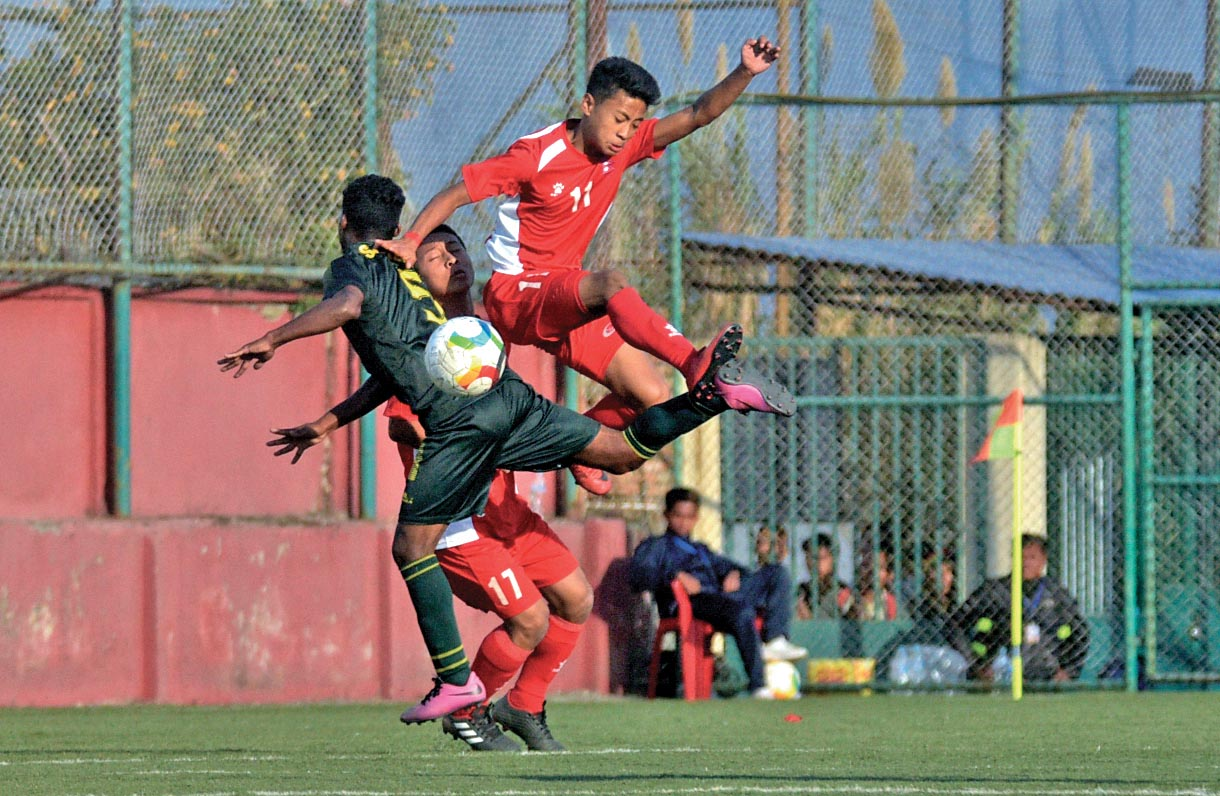 Players of Nepal and Pakistan (left) in action during their SAFF U-15 Football Championship match at the ANFA Complex grounds in Lalitpur on Thursday. Photo: Naresh Shrestha/THT
