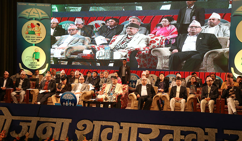 Prime Minister KP Sharma Oli, along with ministers and other high level officals, at the special programme organised to unveil the Social Security Scheme, in Kathmandu, on Tuesday, November 27, 2018. Photo: RSS