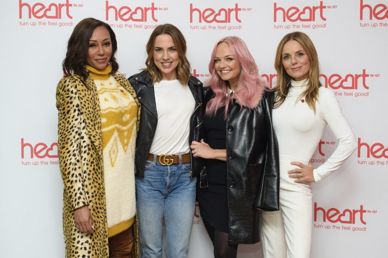 FILE - In this photo, Spice Girls from left, Melanie Brown, Melanie Chisholm, Emma Bunton and Geri Horner pose for a photo during a live appearance on a radio show at Global Radio in Leicester Square, London on Wednesday, Nov. 7, 2018. Photo: AP