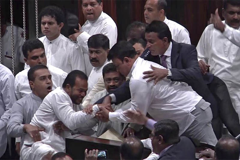 Sri Lanka's lawmakers scuffle at the parliament in Colombo, on Thursday, November 15, 2018. Photo: AP
