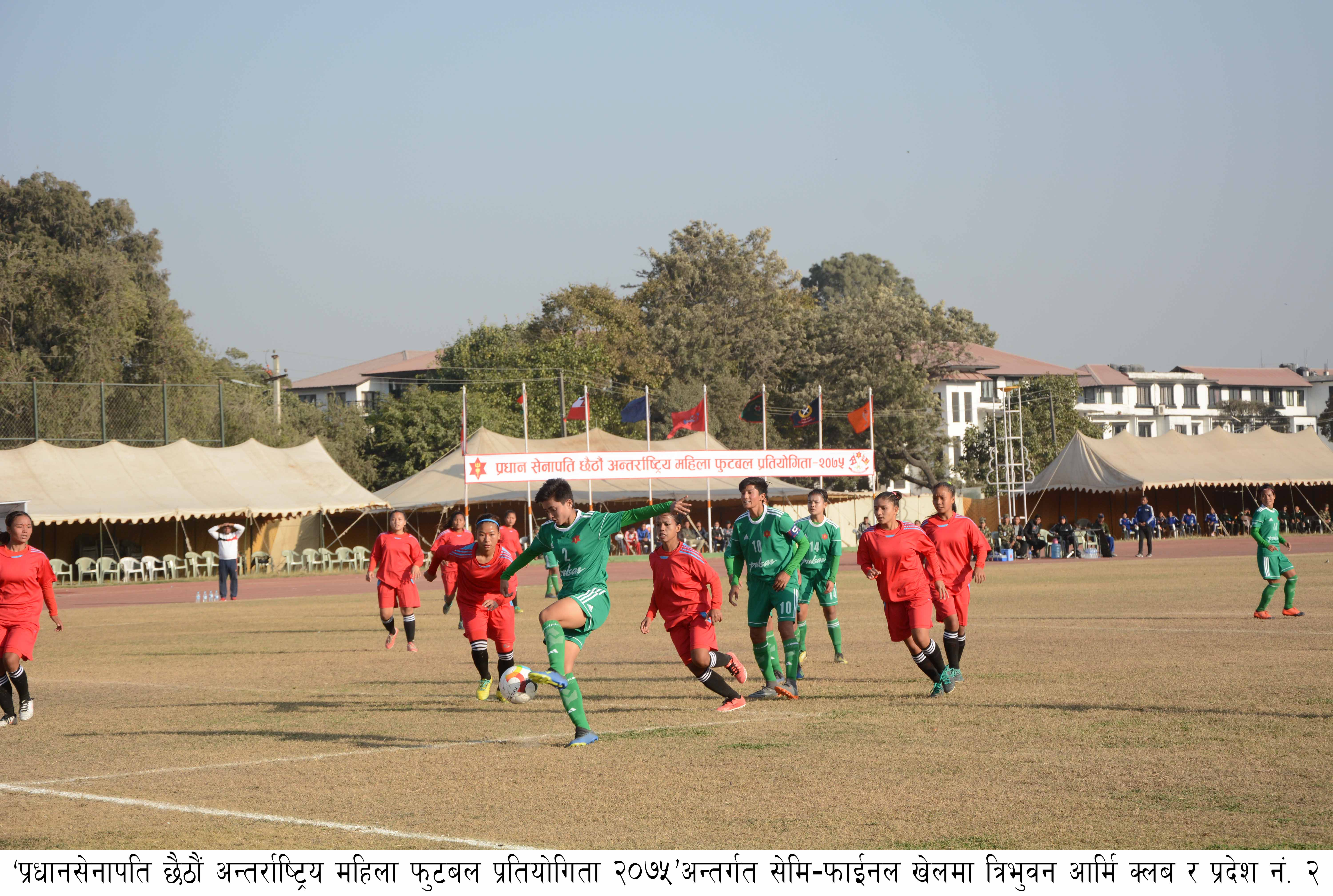 Ashim Gurung of NRT vies with Ajayi Martins Kayode (left) of TSC during their Pulsar Martyrs Memorial AnDivision League match in Lalitpur on Monday, November 26, 2018. Photo: THT