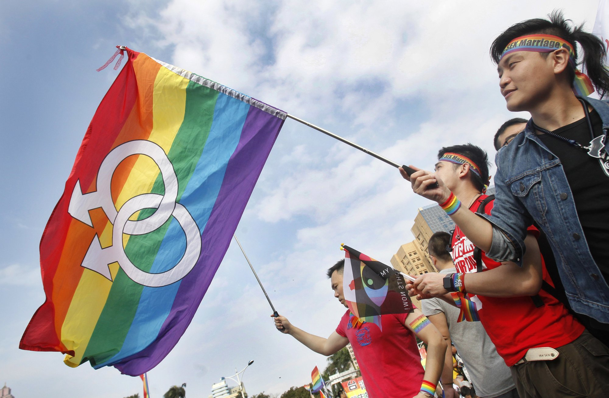 FILE - In this Dec. 10, 2016, file photo, supporters of LGBT and human rights wave rainbow flags during a rally supporting a proposal to allow same-sex marriage in Taipei, Taiwan, on the World Human Rights Day. Photo: AP