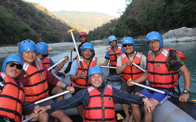 Youths enjoying rafting in the Tamor River in Pinashi, Panchthar, on Wednesday. Photo: THT