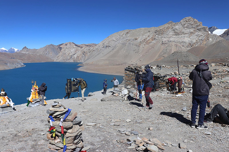 Domestic and foreign tourists enjoying the serene view of Tilicho Lake which is located at an altitude of 4,919 metres above the sea level, in Manang district, as pictured on Wedneday, November 14, 2018. Photo: RSS