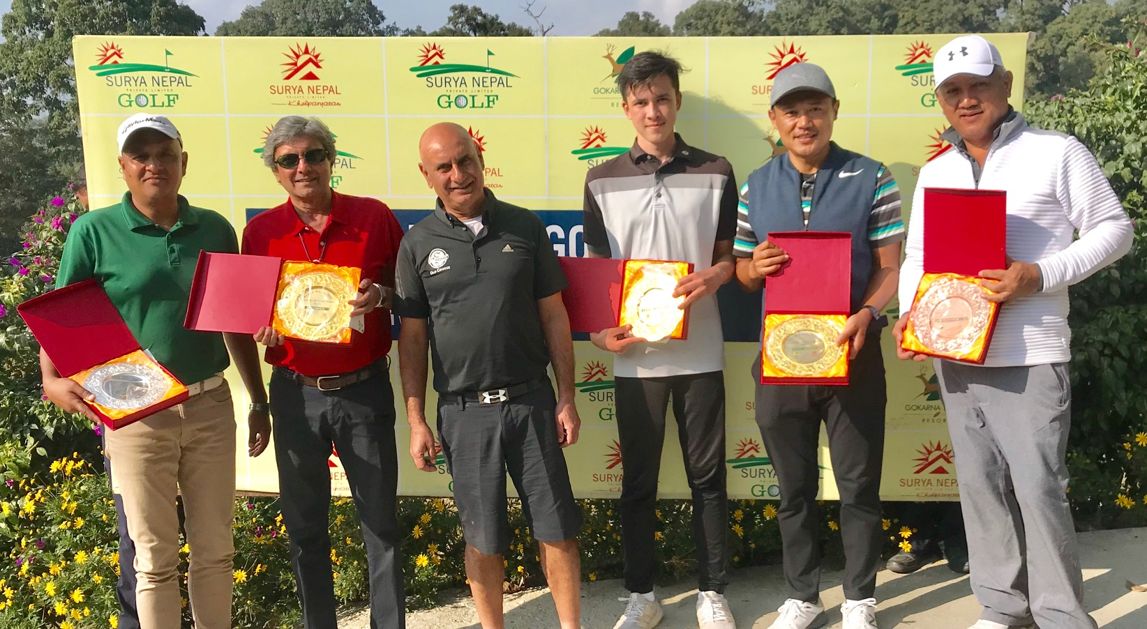 Harish Gorsia (right) and Gaurab Shah hold their trophies after the Surya Nepal Gokarna Monthly Medal at the Gokarna Golf Club in Kathmandu on Saturday, November 10, 2018. Photo: THT