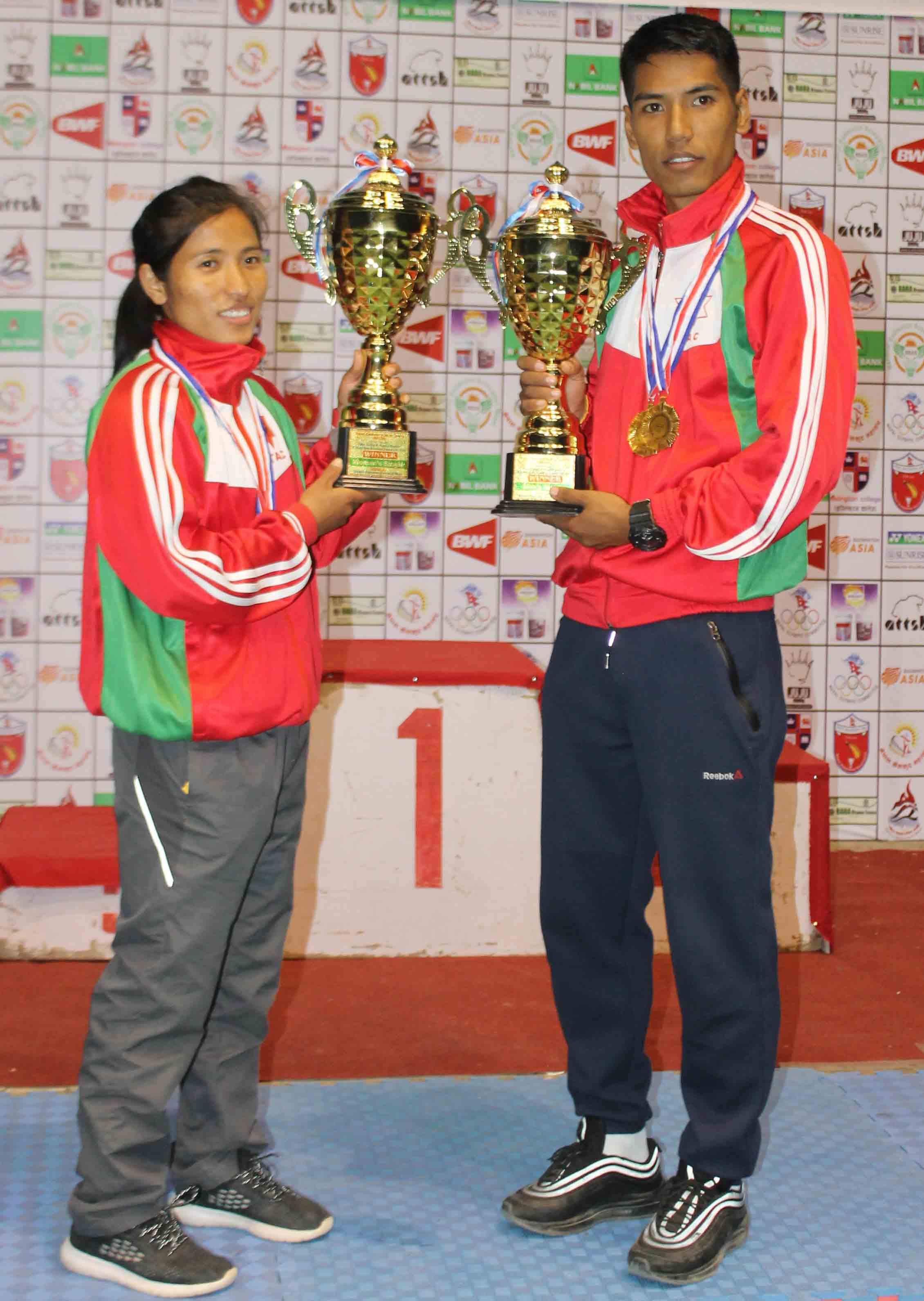 Tamang siblings Nangsal and Ratnajit hold their trophies after the Sunrise Yonex eighth Pushpalal Memorial National Open Badminton in Kathmandu on Saturday, November 17, 2018. Photo: THT