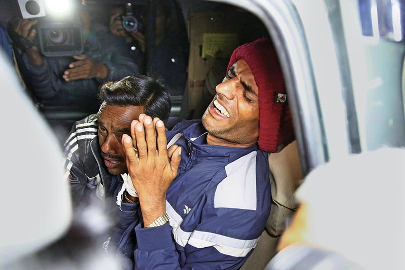 Yagya Raj Panta, father of Nirmala Panta, who was raped and murdered in July, is being brought to TU Teaching hospital for treatment after showing signs of a mental illness in Kathmandu on Sunday. Photo: Skanda Gautam /THT