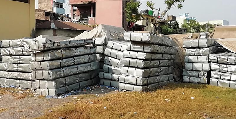 Zinc sheets meant for quake-damaged schools left in the open on the premises of Nepal Food Corporation, Birgunj branch office in Parsa, on Wednesday. Photo: THT