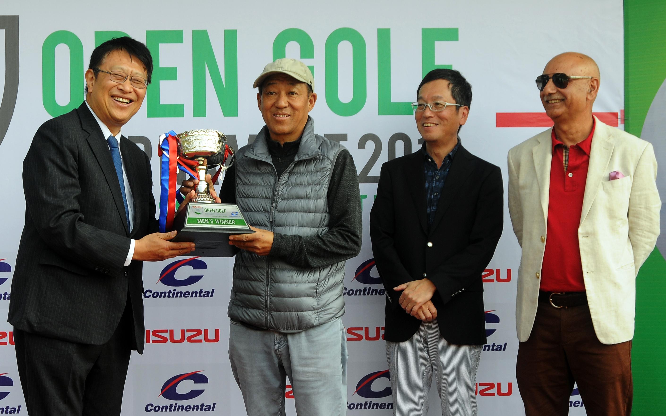 Japanese Ambassador to Nepal Masamiki Saigo (left) handing over the winneru2019s trophy to Tendi Sherpa after the Isuzu Open Golf Tournament at the Gokarna Golf Club in Kathmandu on Saturday. Photo: THT