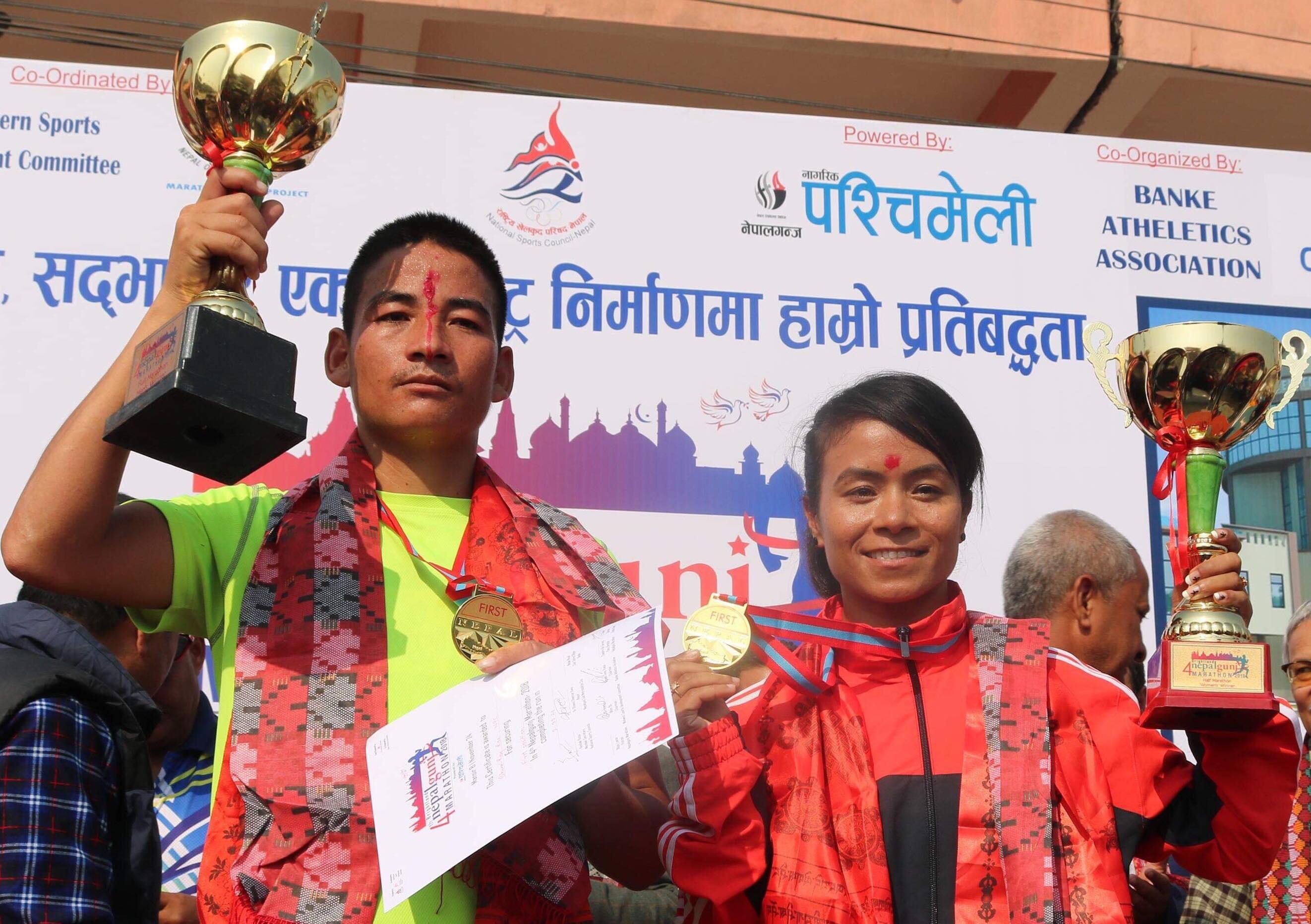 Bhumi Raj Rai and Kanchhi Maya Koju hold their trophies after winning the fourth Nepalgunj Marathon on Saturday. Photo: THT