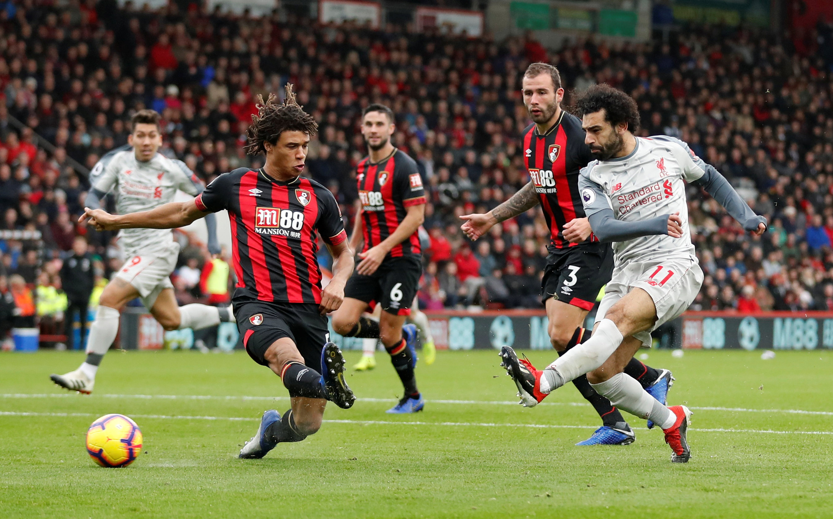 Soccer Football - Premier League - AFC Bournemouth v Liverpool - Vitality Stadium, Bournemouth, Britain - December 8, 2018  Liverpool's Mohamed Salah scores their second goal.   Action Images via Reuters