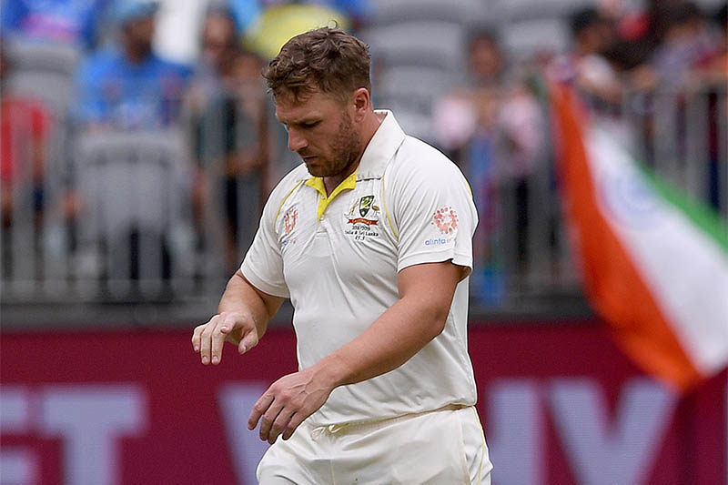 Australia's Aaron Finch looks at his injured finger before retiring hurt, on day three of the second test match between Australia and India, at Perth Stadium in Perth, Australia, December 16, 2018. Photo: Reuters