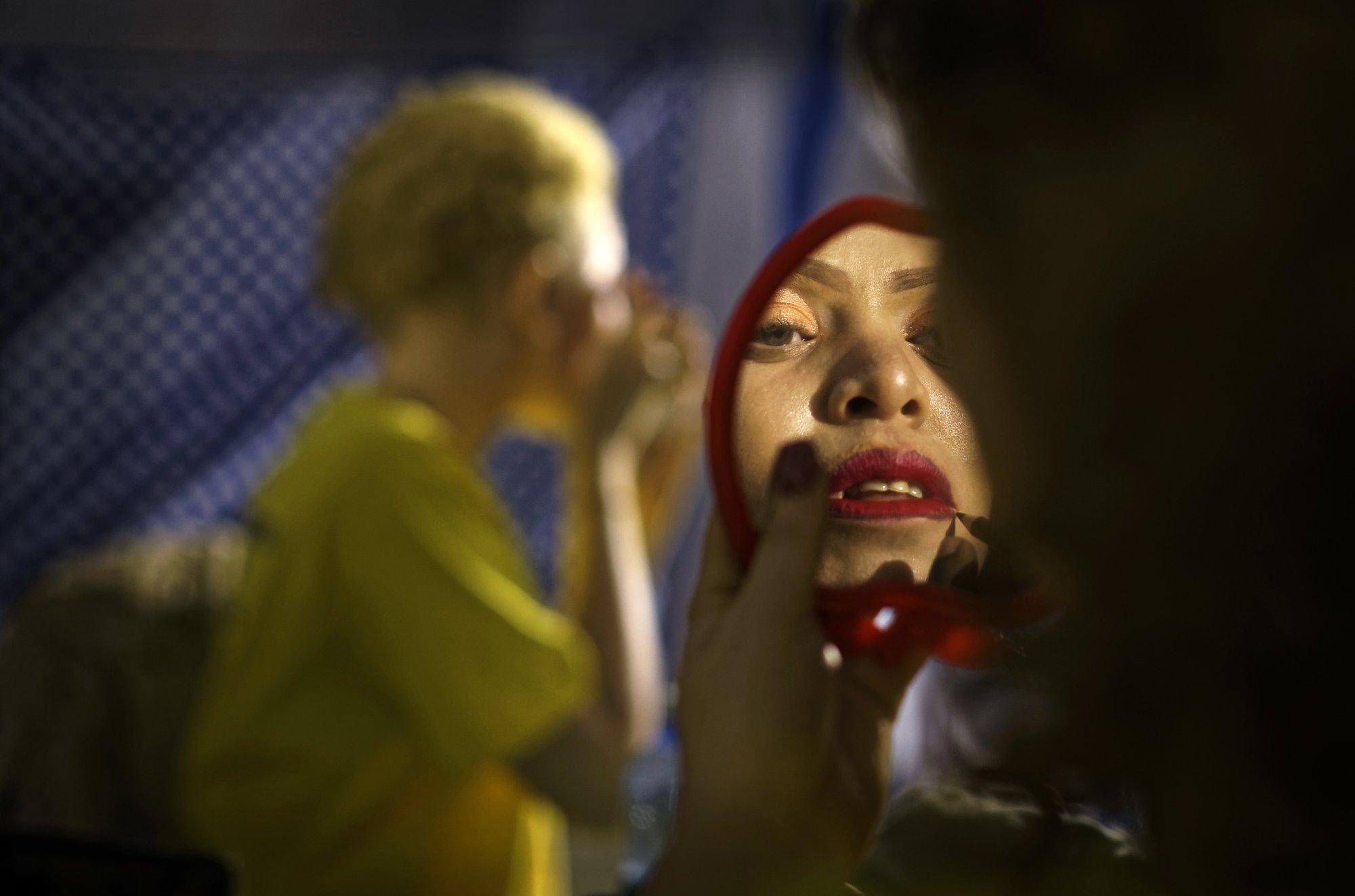 A contestant checks her makeup in a mirror as she prepares to perform in the Mr. & Miss Albinism East Africa contest, organized by the Albinism Society of Kenya, in Nairobi, Kenya on Friday, Nov. 30, 2018. Photo: AP