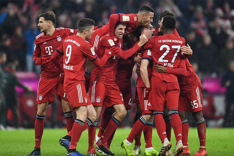 Bayern Munich's Franck Ribery celebrates scoring their first goal with team mates. Photo: Reuters