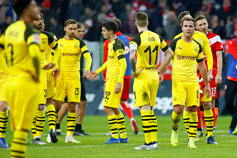 Borussia Dortmund's Christian Pulisic and Mario Goetze react after the match. Photo: Reuters