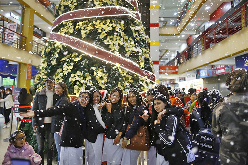 People enjoy artificial snowfall on Christmas at a mall in Kathmandu, on Tuesday, December 25, 2018. Photo: Skanda Gautam/THT