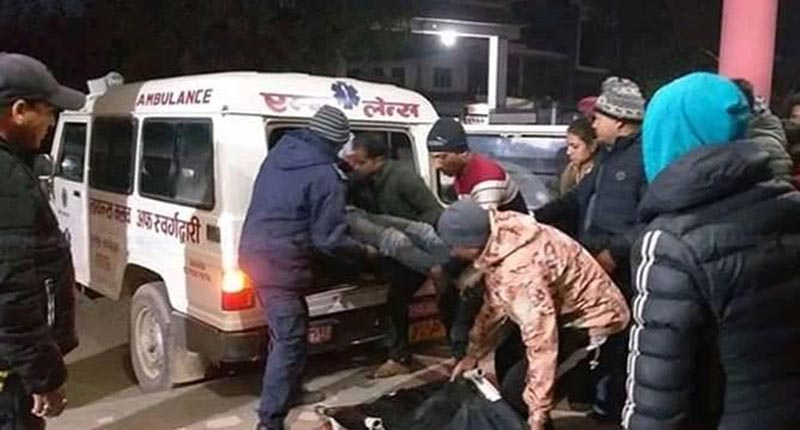 Security personnel carry the injured students into an ambulance. At least 21 students were injured  in a bus accident that took place at Ramri in Tulsipur Sun-metropolitan City-3 along the Tulsipur-Salyan road section, in Dang district, on Friday, December 21, 2018. Photo: RSS