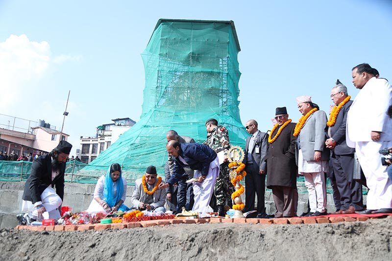 Prime Minister KP Sharma Oli laying the foundation stone for the reconstruction of Dharahara, in Kathmandu, on Thursday, December 27, 2018. Photo: THT