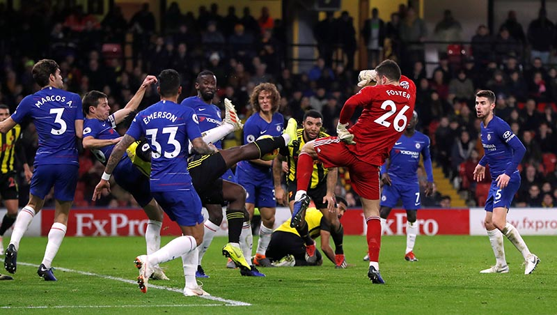 Watford's Ben Foster and Isaac Success in action with Chelsea's Cesar Azpilicueta during the Premier League match between Watford and Chelsea, at Vicarage Road, in Watford, Britain, on December 26, 2018. Photo: Action Images via Reuters