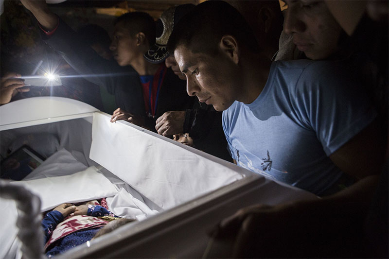 Family members pay their final respects to 7-year-old Jakelin Caal Maquin during a memorial service in her grandparent's home in San Antonio Secoretez, Guatemala, on Monday, December 24, 2018. Photo: AP