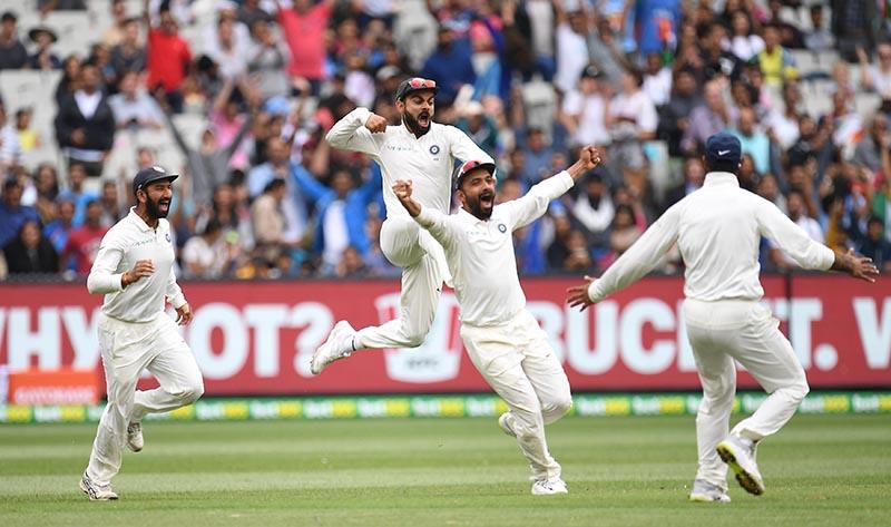 India's captain Virat Kohli, Cheteshwar Pujara and Ajinkya Rahane celebrate after winning the third test match between Australia and India at the MCG in Melbourne, Australia, December 30, 2018.  Photo: AAP/Julian Smith/via Reuters
