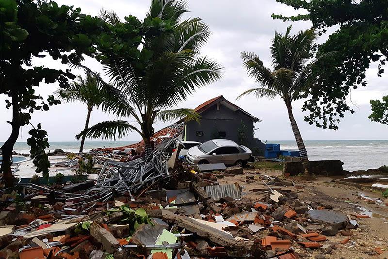 A car is seen among ruins after a tsunami hit Carita beach in Pandeglang, Banten province, Indonesia, December 23, 2018. Photo: Reuters
