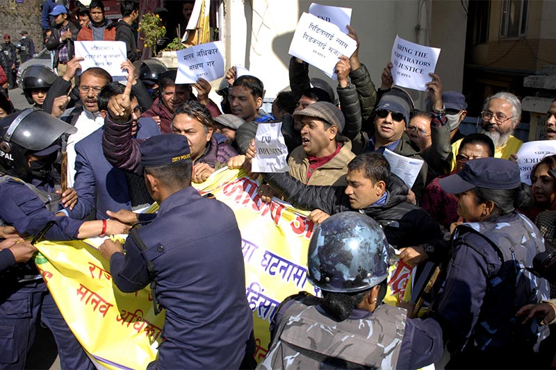 Security personnel arresting human rights activists who staged a demonstration outside the prime ministeru2019s nofficial residence to mark the International Human Rights Day, in Kathmandu, on Monday, December 10, 2018. Photo: Naresh Shrestha/THT