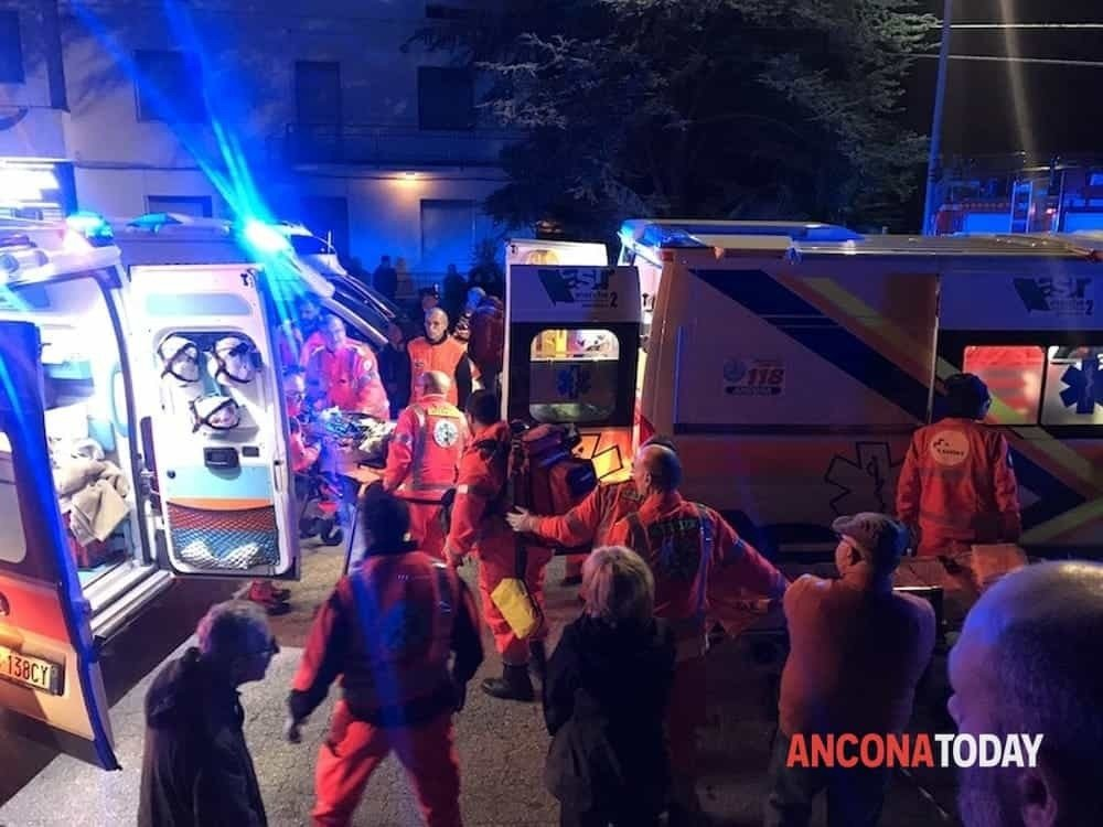 Rescuers assist injured people outside a nightclub in Corinaldo, central Italy, early Saturday, Dec. 8, 2018. Photo: AP