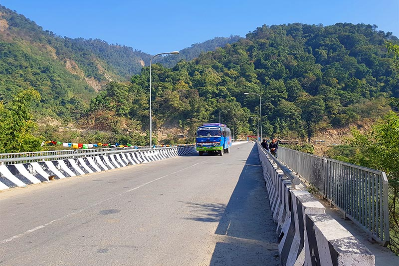 A bus about to ply the bridge over Koshi River in Chatara, Sunsari district, on Monday, December 10, 2018. Photo: Rupak D Sharma/THT