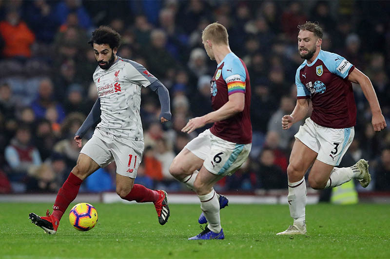 Liverpool's Mohamed Salah in action with Burnley's Charlie Taylor and Ben Mee. Photo: Reuters