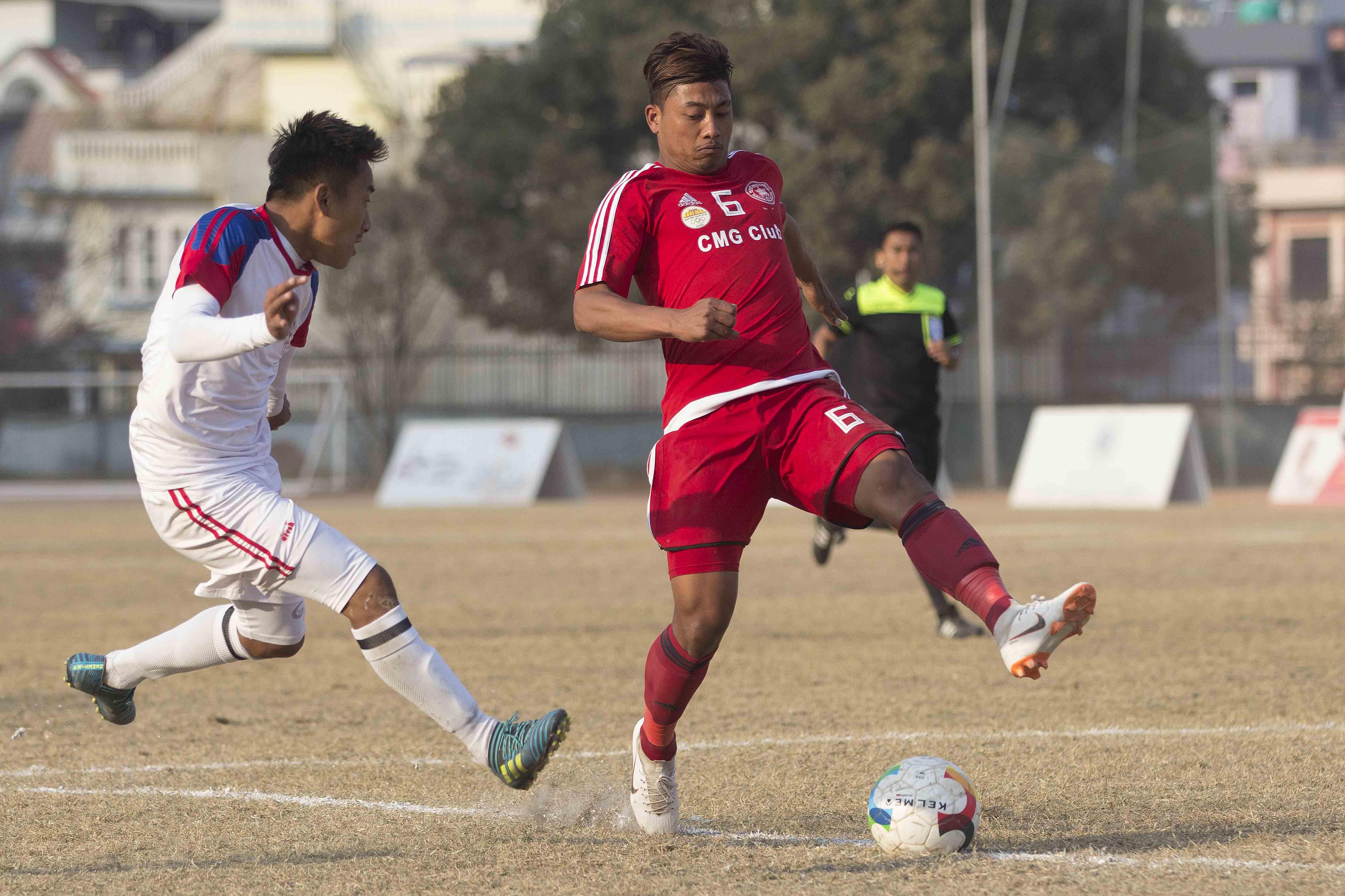 Players of Brigade Boys Club (left) and Sankata Club vie for the ball during their Pulsar Martyru2019s Memorial u2018Au2019 Division League match at APF Stadium in Kathmandu on Saturday, December 22, 2018. Photo: THT